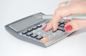calculator hand punching numbers