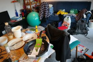 unorganized cluttered dirty room