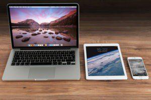 Laptop tablet smartphone wood desk