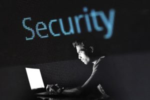 computer hacking man on laptop security title