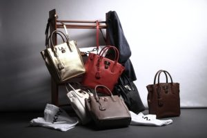 multiple color leather tote bags on rack