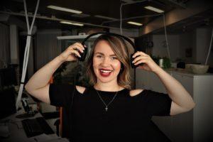 women with headphones smiling