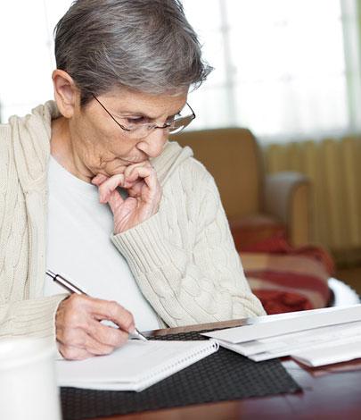 elderly paying bills