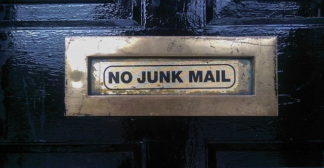 junk mail slot on black door