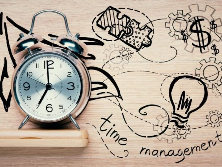 time management with clock light wood background