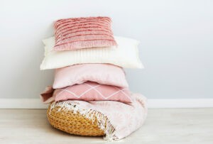 Pink and white pillows on the wall background