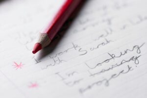 red pencil and lined paper